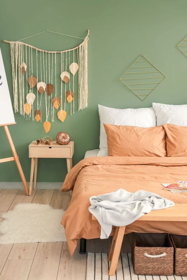 Green-wall-and-brown-bedroom
