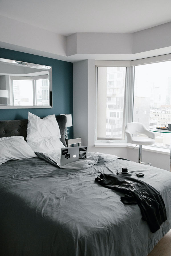 green and blue and gray bedroom