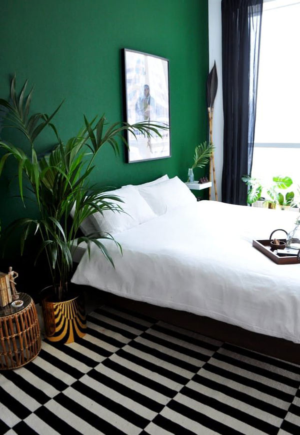 green-walls-and-black-bedroom
