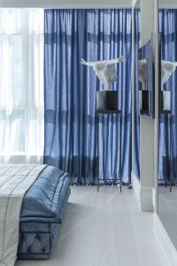 blue-curtains-in-bedroom